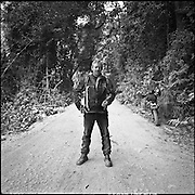 American Steve Christensen takes a break from his motorbike tour of the Ho Chi Minh Trail in Laos. ..