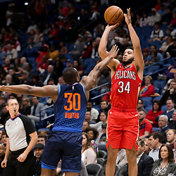 Feb 14, 2019; New Orleans, LA, USA; New Orleans Pelicans guard Kenrich Williams (34) shoots over Oklahoma City Thunder guard Deonte Burton (30) during the first quarter at the Smoothie King Center. Mandatory Credit: Derick E. Hingle-USA TODAY Sports