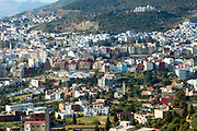 CHEFCHAOUEN, MOROCCO - 27th APRIL 2016 -  Urban cityscape view of the Chefchaouen Medina - the blue city - and Rif Mountain landscape setting, Northern Morocco.