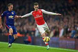 LONDON, ENGLAND - Saturday, November 22, 2014: Arsenal's Calum Chambers in action against Manchester United during the Premier League match at the Emirates Stadium. (Pic by David Rawcliffe/Propaganda)