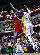 April 21, 2012; Indianapolis, IN, USA; Philadelphia 76ers small forward Andre Iguodala (9) shoots the ball against Indiana Pacers center Roy Hibbert (55) at Bankers Life Fieldhouse. Mandatory credit: Michael Hickey-US PRESSWIRE