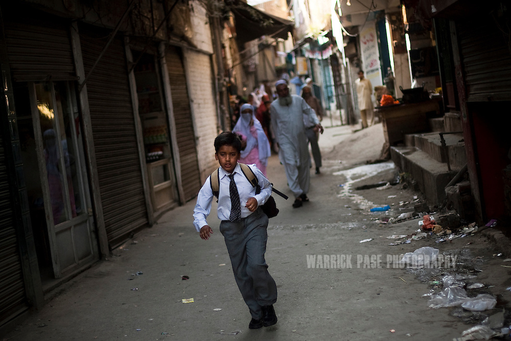 A boy runs to school, on 5 May, 2011, in Abbottabad, Pakistan. Bin Laden was killed during a U.S. military mission on May 2, at the compound.  The operation, code-named Operation Neptune Spear, was launched from neighbouring Afghanistan by Seal Team Six. U.S. forces took bin Laden's body to Afghanistan for identification, then dumped it the Arabian Sea. Pakistan has since been widely suspected as having prior knowledge of his whereabouts as the compound was less than a kilometre from the country's biggest military academy. Osama bin Laden was allegedly responsible for supporting the bombing of the US Embassy in Nairobi, Kenya, the attack on the USS Cole and the suicidal attacks of September 11, 2001 in the US. (Photo by Warrick Page)