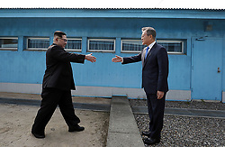 April 27, 2018 - Panmunjom, Korea - North Korean leader KIM JONG UN, left, prepares to shake hands with South Korean President MOON JAE-IN at the border village of Panmunjom in Demilitarized Zone. Their discussions will be expected to focus on whether the North can be persuaded to give up its nuclear bombs. (Credit Image: © Prensa Internacional via ZUMA Wire)