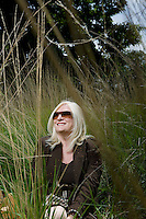 Woman Sitting in Tall Grass