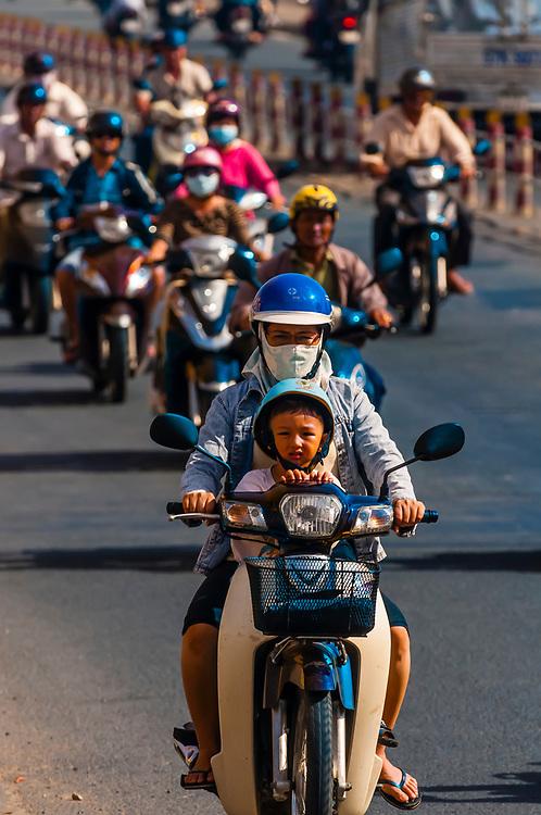 Motorcycles crossing over the Cau Cai Rang Bridge in the Mekong Delta, Vietnam.
