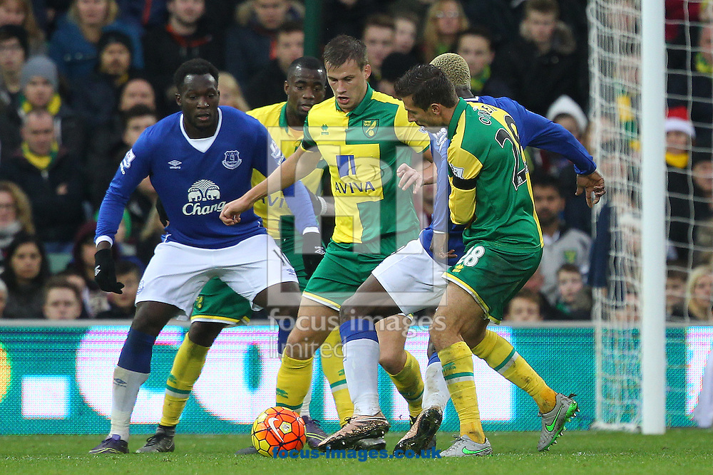 Gary O&rsquo;Neil of Norwich, Ryan Bennett of Norwich and Arouna Kon&eacute; of Everton in action during the Barclays Premier League match at Carrow Road, Norwich<br /> Picture by Paul Chesterton/Focus Images Ltd +44 7904 640267<br /> 12/12/2015