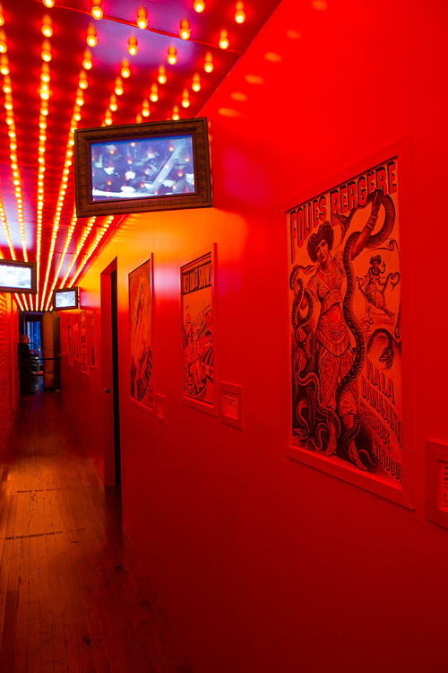 A red-lit corridor lined with posters of the Folies Bergère and other attractions leads to Jump for Joy, a bouncy castle of breasts.