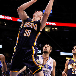 March 11, 2012; Orlando, FL, USA; Indiana Pacers power forward Tyler Hansbrough (50) shoots over Orlando Magic power forward Ryan Anderson (33) during the fourth quarter of a game at  Amway Center. The Magic defeated the Pacers 107-94.  Mandatory Credit: Derick E. Hingle-US PRESSWIRE