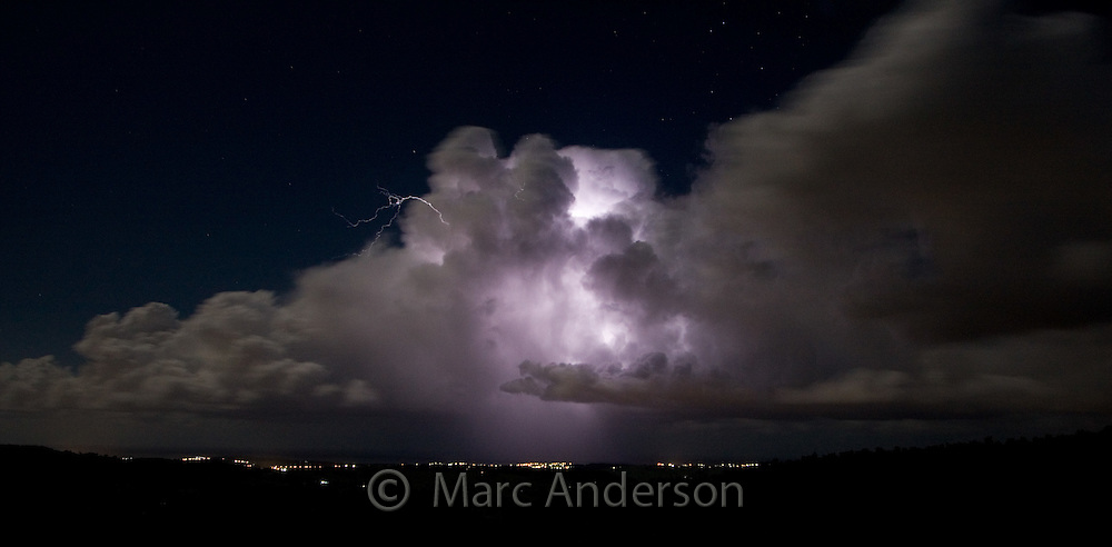 Sky lit up by lightning coming from a huge storm cloud, Albion Park, NSW, Australia