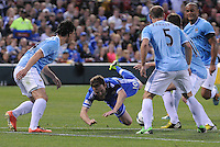 Football - Premier League - Chelsea Training for friendly with Man City St. Louis, MO/USA. Manchester City won, 4-3 over Chelsea.  Chelsea FC player Juan Mata (10) falls to the turf amid a group of Manchester City players late in the first half...
