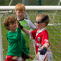 Luca Melle and Nigel Kelly high five during their match at the  FAI Eflow Summer Soccer School in Lisdoonvarna