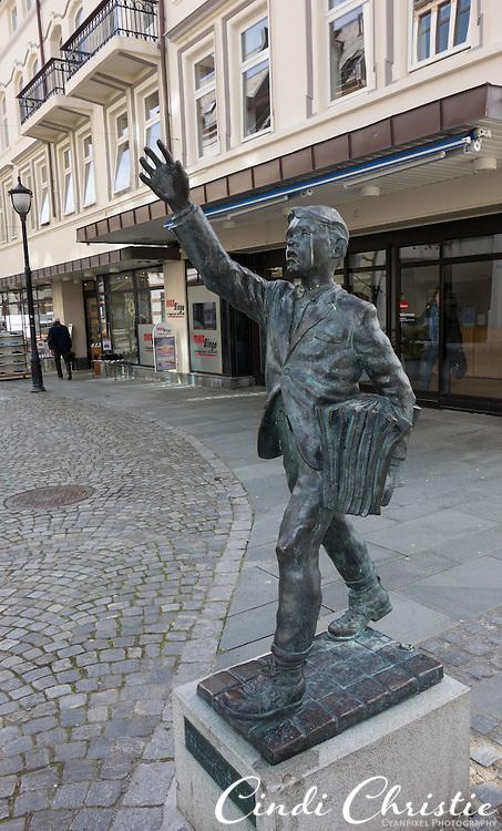 """A statue of a newspaper boy, """"Avisgutten"""" by Arne Martin Hansen, is found on Gågaten in Ålesund, Norway, on May 14, 2013.   (© 2013 Cindi Christie)"""