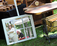 Milly Collagen of West Chetser, Pennsylvania is reflected in a mirror as she walks though the Tinicum Arts Festival which featured about 100 vendors and 180 artists and crafts people Saturday July 11, 2015 in Tinicum, Pennsylvania. (Photo by William Thomas Cain)