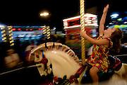 Emily Grundel, 4, rides the carousel at the California State Fair on September 3, 2007.