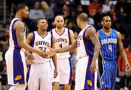 Dec. 09, 2012; Phoenix, AZ, USA; Phoenix Suns forward Markieff Morris (11) , guard Sebastian Telfair (31) and guard Shannon Brown (26) talk on the court as the Orlando Magic guard Arron Afflalo (4) walks by in the first half at US Airways Center. Mandatory Credit: Jennifer Stewart-USA TODAY Sports