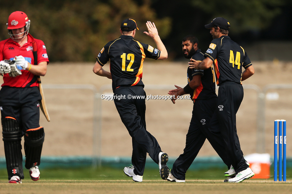Jeetan Patel of the Firebirds celebrates with team mates after dismissing Henry Nicholls of the Wizards during the Preliminary Final in the Ford Trophy One-Day cricket match between the Canterbury Wizards v Wellington Firebirds at Hagley Oval, Christchurch. 2 April 2014 Photo: Joseph Johnson/www.photosport.co.nz
