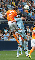 Football - Major League Soccer - Houston Dynamo at Sporting KC - The Sporting KC and the Houston Dynamo played to a 1-1 tie in regulation time at Sporting KC Park in Kansas City, Kansas, USA. Houston Dynamo defender Eric Brunner (2) and Sporting KC forward Claudio Bieler (16) leap for a header in the first half. .