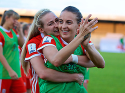 NEWPORT, WALES - Tuesday, June 12, 2018: Wales' Rhiannon Roberts (left) and two-goal hero Kayleigh Green celebrate after beating Russia 3-0 during the FIFA Women's World Cup 2019 Qualifying Round Group 1 match between Wales and Russia at Newport Stadium. (Pic by David Rawcliffe/Propaganda)