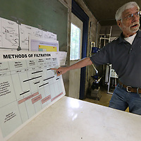 Wil Howie looks over his water filtration chart.