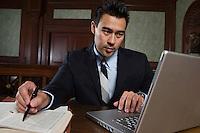 Man using laptop in court