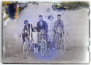 eroding glass plate image with family and their bicycles
