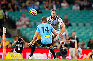 SYDNEY, NSW - MARCH 23: Crusaders player Quinten Strange (4) puts a kick past Waratahs player Cam Clark (14) at round 6 of Super Rugby between NSW Waratahs and Crusaders on March 23, 2019 at The Sydney Cricket Ground, NSW. (Photo by Speed Media/Icon Sportswire)