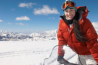 Woman Standing Up on Snowmobile