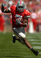 COPYRIGHT DAVID RICHARD Ohio State's Ted Ginn finds open field during the first half yesterday against Miami.