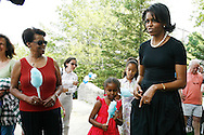 Michelle Obama, wife of Democratic presidential hopeful Senator Barack Obama, speaks to with her daughter Sasha(C) and mother Marian Robinson(L) supporters during a rally in Concord, New Hampshire June, 2, 2007. .