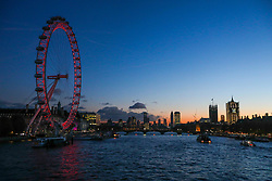 © Licensed to London News Pictures. 18/11/2019. London, UK. Visitors to the London Eye enjoy a sunset over the Thames towards the Houses of Parliament and Vauxhall Cross as the Met Office issue a yellow weather warning for freezing fog with disruption to transport tomorrow as temperatures are set to tumble to -2 in the London area . Photo credit: Alex Lentati/LNP