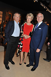 Left to right, LORD ARCHER and LORD & LADY CHADLINGTON he is Chairman of LAPADA at a preview evening of the annual London LAPADA (The Association of Art & Antiques Dealers) antiques Fair held in Berkeley Square, London on 18th September 2012.