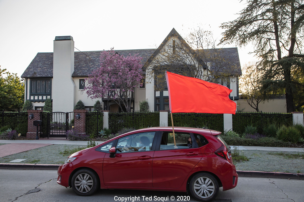 Angelenos hold a drive-by protest in their cars, due to 6 feet Covid-19 rule, honking at L.A. Mayor Eric Garcetti's mansion. They are calling on mayor to extend the rent eviction and mortgage pause till the end of the year. L.A. City Council has rejected approval of the extension.