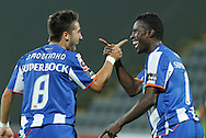 Portugal, FUNCHAL : FC Porto's midfielder Joao Moutinho (L) and forward Silvestre Varela (R) celebrate their team's goal against Nacional during their Portuguese League football match at Madeira Stadium in Funchal, Portugal on September 20, 2010..PHOTO/ GREGORIO CUNHA......Liga Portuguesa de Futebol, Estadio da Madeira..Nacional vs F.C. Porto.Joao Moutinho e Varela.Foto Gregorio Cunha