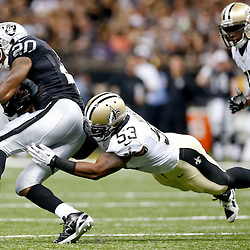 Aug 16, 2013; New Orleans, LA, USA; New Orleans Saints linebacker Ramon Humber (53) tackles Oakland Raiders running back Darren McFadden (20) during the first quarter of a preseason game at the Mercedes-Benz Superdome. Mandatory Credit: Derick E. Hingle-USA TODAY Sports