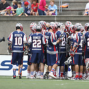 Members of the Boston Cannons huddle up during the game at Harvard Stadium on July 19, 2014 in Boston, Massachusetts. (Photo by Elan Kawesch)