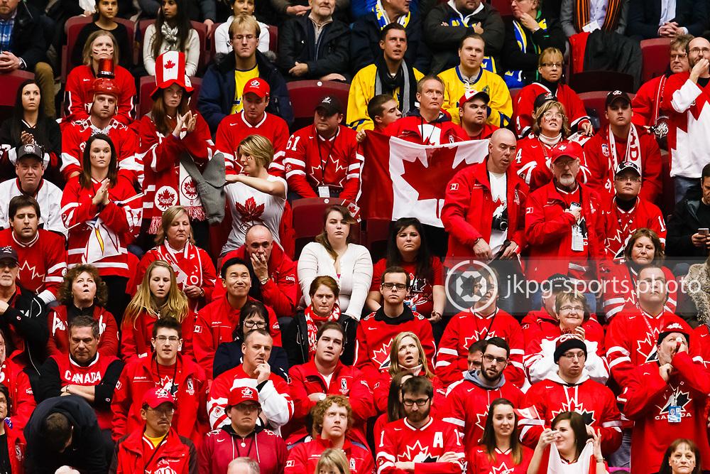 140104 Ishockey, JVM, Semifinal,  Kanada - Finland<br /> Icehockey, Junior World Cup, SF, Canada - Finland.<br /> Canadian fans with sad faces during the game.<br /> Kanadensiska supportrar med nedst&auml;md min under matchen.<br /> Endast f&ouml;r redaktionellt bruk.<br /> Editorial use only.<br /> &copy; Daniel Malmberg/Jkpg sports photo