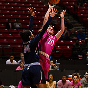 10 February 2018: The San Diego State Aztecs women's basketball team hosts Nevada on Play4Kay day at Viejas Arena. San Diego State Aztecs guard Geena Gomez (20) attempts a contested jump shot against Nevada Wolf Pack guard Jade Redmon (34) late in the second half. The Aztecs beat the Wolfpack 75-72. <br /> More game action at www.sdsuaztecphotos.com