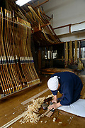 Keitarou Yokoyama shaping a piece of bamboo as part of the bow making process. Yokoyama Reimei Bowmakers, Miyakonojo, Miyazaki Prefecture, Japan, December 23, 2016. A handful of bowyers from the Kyushu city of Miyakonojo make over 90% of all the bows used in traditional Japanese archery. The bows are made from laminated bamboo and haze wood in process that consists of over 200 individual tasks. At over two meters from tip to tip the bows the longest used in the world.