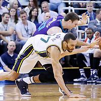 27 January 2016: Utah Jazz center Rudy Gobert (27) vies for the loose ball with Charlotte Hornets forward Tyler Hansbrough (50) during the Utah Jazz 102-73 victory over the Charlotte Hornets, at the Vivint Smart Home Arena, Salt Lake City, Utah, USA.