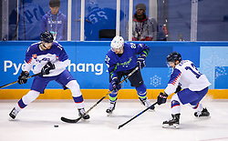GANGNEUNG, SOUTH KOREA - FEBRUARY 17: Marcel Rodman of Slovenia between Peter Ceresnak of Slovakia and Michal Kristof of Slovakia during the ice hockey match between Slovenia and Slovakia in  the Preliminary Round on day eight of the PyeongChang 2018 Winter Olympic Games at Kwangdong Hockey Centre on February 17, 2018 in Gangneung, South Korea. Photo by Kim Jong-man / Sportida