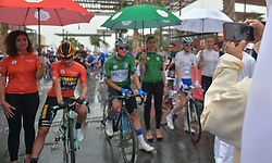 March 1, 2019 - Ajman, United Arab Emirates - Chairman of the Economic Department of Ajman Emirate Takes a photo of the Leader Red Jersey (General Classification), Primoz Roglic of Slovenia and Team Jumbo - Visma, and the Green Jersey (General Points), Stepan Kurianov of Rusia and Team Gazprom-Rusvelo, at the start line of the sixth Rak Properties Stage of UAE Tour 2019, a 180km with a start from Ajman and finish in Jebel Jais. .On Friday, March 1, 2019, in Ajman, Ajman Emirate, United Arab Emirates. (Credit Image: © Artur Widak/NurPhoto via ZUMA Press)