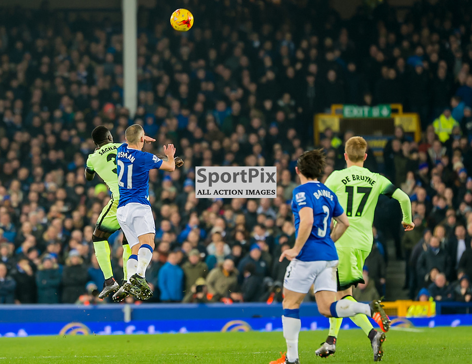 Manchester City defender Bacary Sagna and Everton midfielder Leon Osman challenge for a header in the Football League cup semi-final first leg at Goodison Park, Liverpool