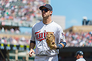 Joe Mauer #7 of the Minnesota Twins heads to the dugout during a game against the Seattle Mariners on June 2, 2013 at Target Field in Minneapolis, Minnesota.  The Twins defeated the Mariners 10 to 0.  Photo: Ben Krause