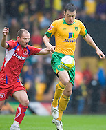 Norwich City - Saturday May 8 2010: Russell Martin of Norwich City plays for the ball against Carlisle's Ian Harte during match at Carrow Road, Norwich. (Pic by Rob Colman Focus Images)