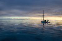 Patagonia ambassador Liz Clark and her boat Swell anchored at sunset in French Polynesia.