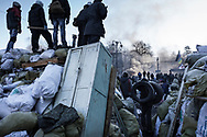 Standoff between anti government protesters and riot police on Hrushevskoho street near Maidan Square, in Kiev, 24 January 2014.