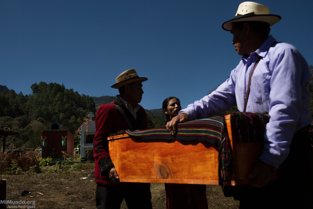 Friends and family bury the human remains of 36 Ixil Mayan war victims. Most of the victims, exhumed from mass graves in Xe'xuxcap, near Acul, starved in the mountainside while fleeing State-led repression in 1982. Most of the remains, exhumed by members of the Forensic Anthropology Foundation of Guatemala (FAFG) in 2013, were identified using DNA analysis and properly buried 35 years after their death. Acul, Nebaj, Quiché, Guatemala. February 3, 2017.