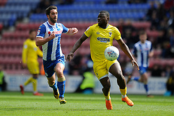 Adedeji Oshilaja of AFC Wimbledon vies for the ball with Will Grigg of Wigan Athletic - Mandatory by-line: Greig Bertram/JMP - 28/04/2018 - FOOTBALL - DW Stadium - Wigan, England - Wigan Athletic v AFC Wimbledon -