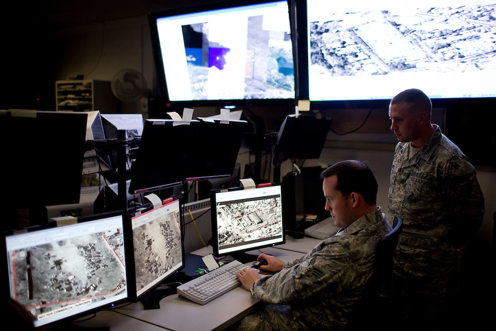 Intelligence analyst Senior Airman Patrick Carrol, center, and imagery mission supervisor Staff Sergeant Brian Sands, right, at work on the operations floor at Beale Air Force Base in Linda, Calif., April 7, 2010.