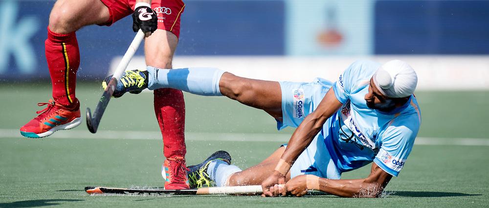 BREDA - Rabobank Hockey Champions Trophy<br /> India - Belgium<br /> Photo: Mandeep Singh falls after his shot at goal.<br /> COPYRIGHT WORLDSPORTPICS FRANK UIJLENBROEK
